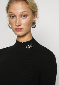 Calvin Klein Jeans - ROLL NECK DRESS - Jumper dress - black - 4