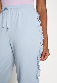 ONLY - ONLAVA FRILL  - Tracksuit bottoms - blue - 3