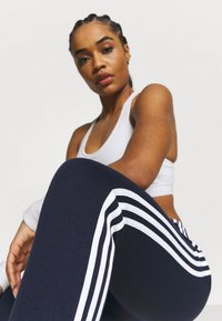 adidas Performance - ESSENTIALS FRENCH TERRY STRIPES PANTS - Tracksuit bottoms - legend ink/white - 3
