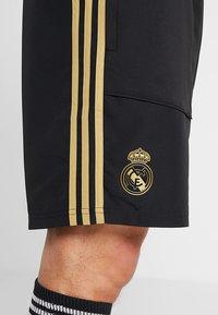 adidas Performance - REAL MADRID - Sports shorts - black/dark gold - 6