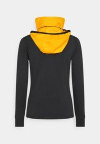 Kjus - WOMEN MUNDIN MIDLAYER JACKET - Fleecová bunda - black mel/gold honey yellow - 2