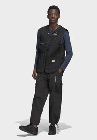 adidas Originals - ADV Woven PANTS ADVENTURE ORIGINALS REGULAR TRACK - Tracksuit bottoms - black - 1