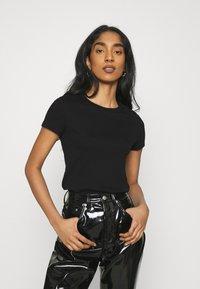 Monki - MAGDALENA TEE 2 PACK - Print T-shirt - black dark solid/lilac - 3
