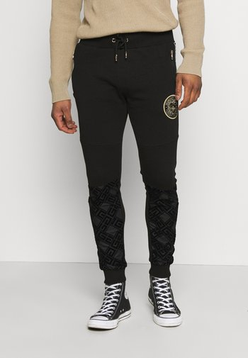 SINTOS JOGGER - Pantaloni sportivi - black/gold