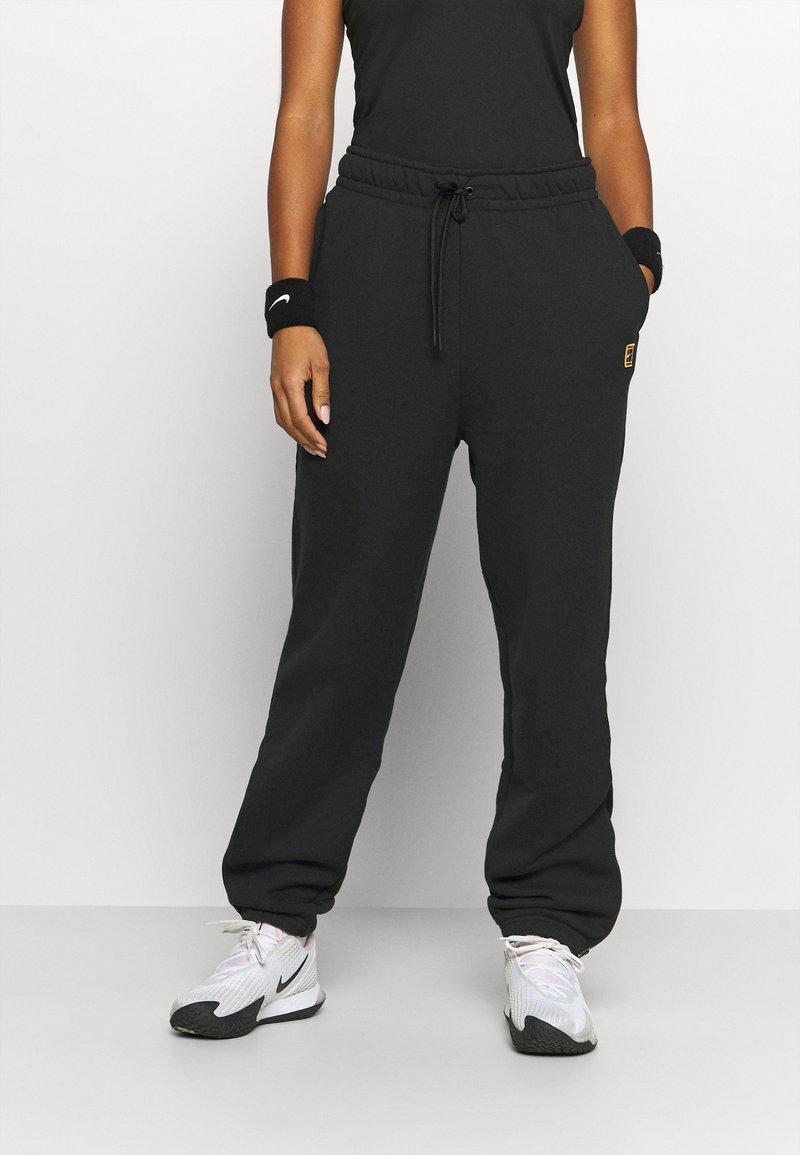 Nike Performance - HERITAGE PANT - Tracksuit bottoms - black