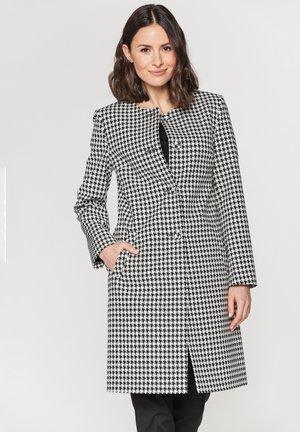 Klasyczny płaszcz - biało-czarny