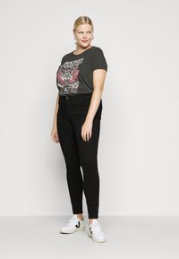 Vero Moda Curve - VMTANYA PIPING - Jeans Skinny Fit - black - 1