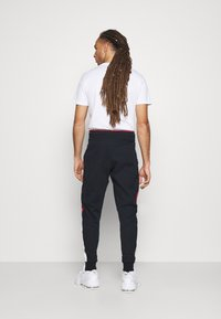 Tommy Hilfiger - CUFFED BLOCKED PANT - Tracksuit bottoms - blue - 2