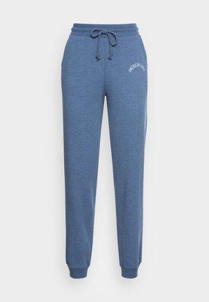 BRANDED SLIM JOGGER - Tracksuit bottoms - blue