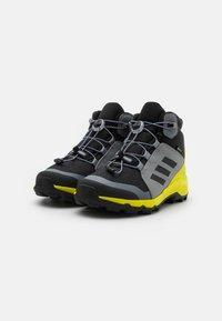 adidas Performance - TERREX MID GTX UNISEX - Hiking shoes - core black/grey three/acid yellow - 1