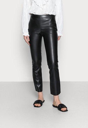 FREDDIE - Trousers - black