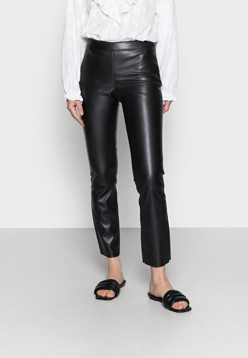 Carin Wester - FREDDIE - Trousers - black