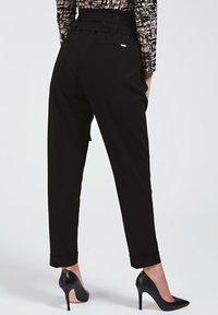Guess - Trousers - noir - 2