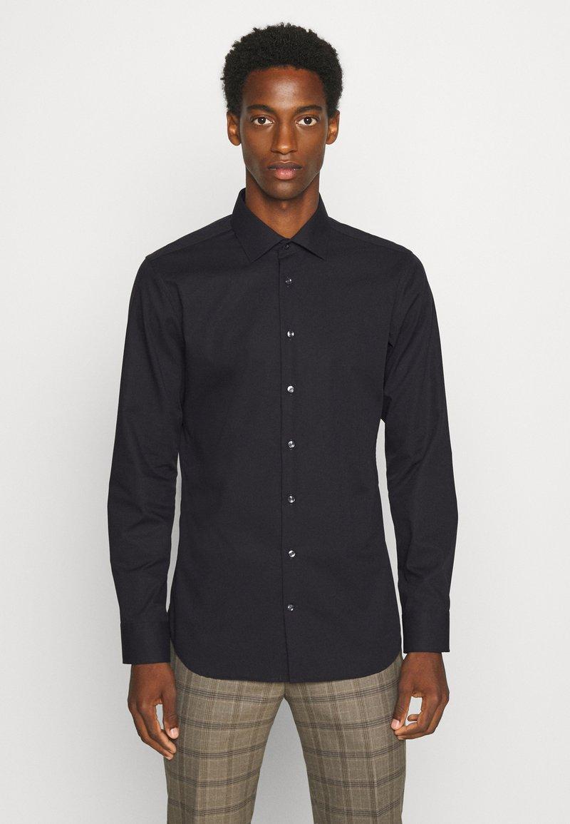 Seidensticker - MODERN KENT X SLIM - Formal shirt - black