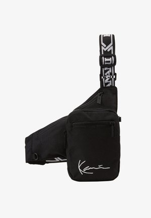 SIGNATURE TAPE BODY BAG - Rumpetaske - black/white