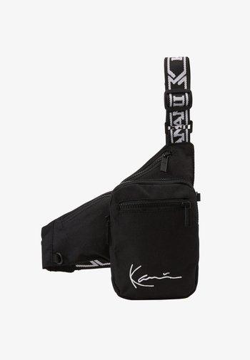 SIGNATURE TAPE BODY BAG - Bum bag - black/white
