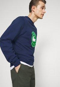 Lacoste - Sweatshirt - scille - 3