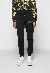 Versace Jeans Couture - Spodnie treningowe - black - 0