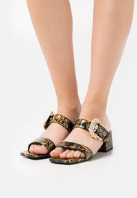 Versace Jeans Couture - Heeled mules - black - 0