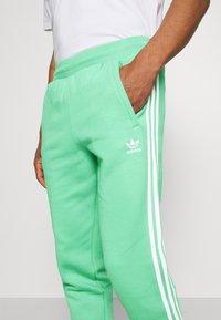 adidas Originals - 3 STRIPES PANT - Tracksuit bottoms - semi screaming green - 4
