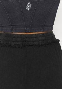 Free People - SURE THING PANT - Pantalones deportivos - black - 5