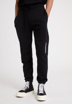 PAADRO AACT - Tracksuit bottoms - black