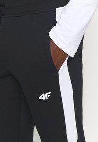 4F - Men's sweatpants - Träningsbyxor - black - 3