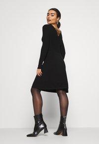 ONLY Petite - ONLSTRING DRESS - Pletené šaty - black - 2