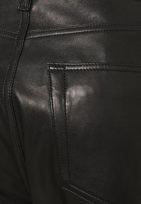 Iro - GNEISS TROUSERS - Spodnie skórzane - black - 7