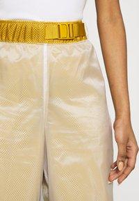 Nike Sportswear - PANT - Tracksuit bottoms - dark citron/white/black - 4