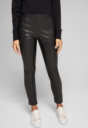 SARA - Leather trousers - black