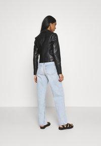 Vero Moda - VMHOPE COATED JACKET - Faux leather jacket - black - 2
