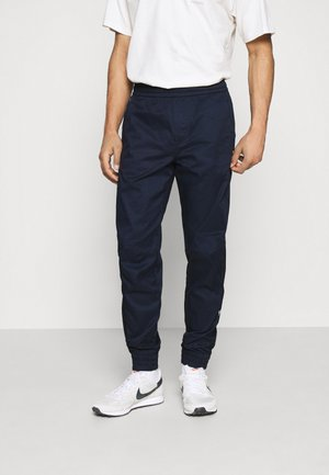CUFFED TRAINER - Cargo trousers - sartho blue
