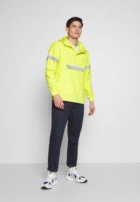 INDICODE JEANS - COLLEGE - Windbreaker - neon yellow - 1