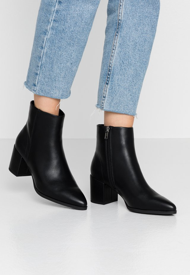 DAFNII - Classic ankle boots - black