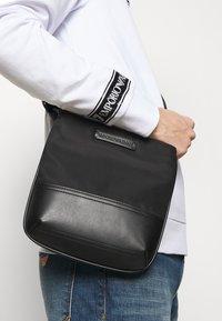 Emporio Armani - MESSENGER BAG UNISEX - Torba na ramię - black - 1
