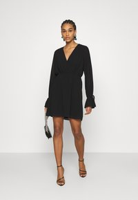 NA-KD - STRAP TIE MINI DRESS - Day dress - black - 1