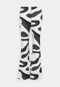 HOSBJERG - PALOMA PANTS - Trousers - black/white - 0