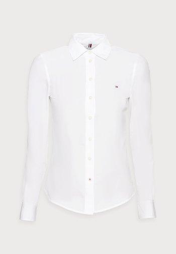 REGULAR SHIRT - Button-down blouse - white
