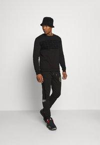 Glorious Gangsta - ESTEN CREW - Sweatshirt - black - 1
