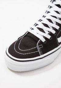 Vans - SK8 TAPERED - Sneakers hoog - black/true white - 6