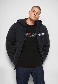 MOSCHINO - Winter jacket - black - 5