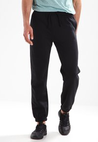 Kappa - SNAKO - Pantalon de survêtement - black - 0