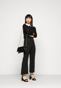 Even&Odd Petite - Flared PUNTO trousers - Leggings - black - 1