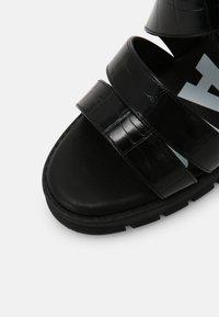 Buffalo - VEGAN RAGAN - Platform sandals - black - 7