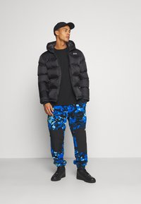 The North Face - DENALI PANT - Spodnie treningowe - clear lake blue - 1