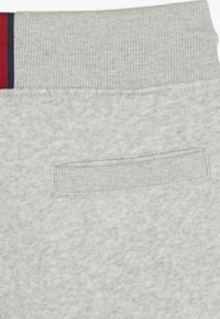 Tommy Hilfiger - ESSENTIAL - Tracksuit bottoms - grey - 5