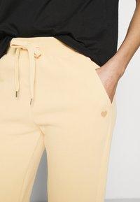 Opus - MALEA - Tracksuit bottoms - apricot - 3