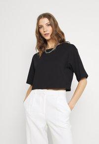 Monki - 2 PACK - T-shirts - black dark/white light - 3
