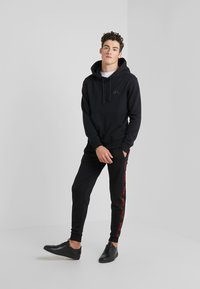 HUGO - DASCHKENT - Spodnie treningowe - black - 1